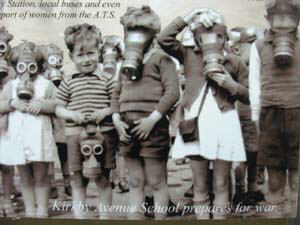 old photo children holding gas masks