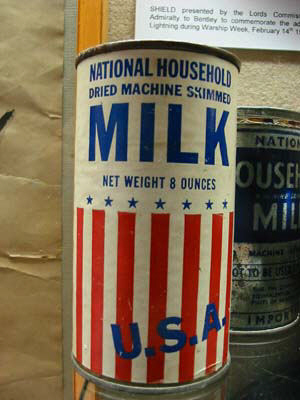 tin of dried milk from USA net weight 8 ounces